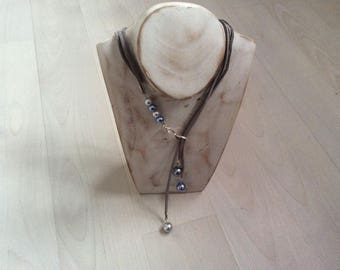 Grey pearls and gray suede necklace.