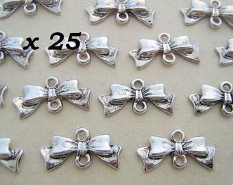 Set of 25 silver ribbon bow connectors antiqued 10 x 20 mm - L25630
