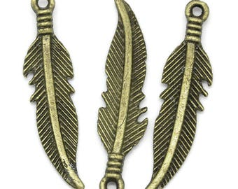 4 charms / pendants bronze feather