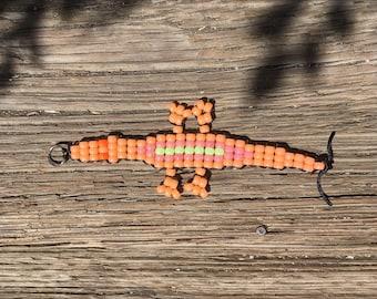 Sunburst orange lizard kandi keychain