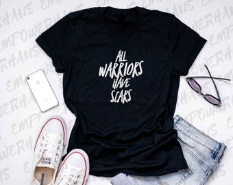 "Breast Cancer Tee - ""All Warriors Have Scars"" WOMENS TEE - Inspirational Quote - Mastectomy Shirt - Chemo Care Package - Womens Empowerment"