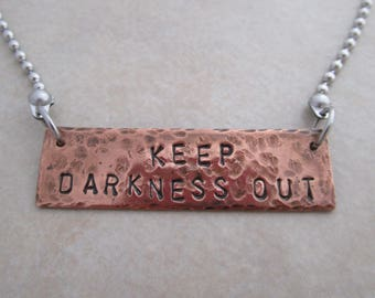 keep darkness out necklace stainless steel oxidized copper