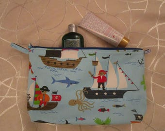 """large case waterproof """"pirates"""" blue printed cotton fabric, lined with white faux"""