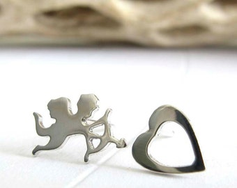 Cupid and heart stud earrings. Valentines day jewelry in sterling silver or 14k gold. Love gift. Cute mismatched posts. Minimalist jewelry.