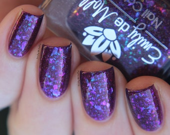 """Nail polish - """"Teller Of tales"""" A purple with copper shimmer and iridescent flakes."""