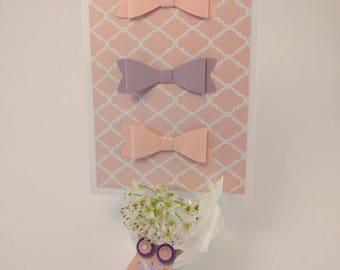 Handmade scrapbooking card in soft pink tones
