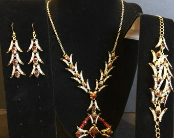 Rhinestone and ruby accents set in antique gold