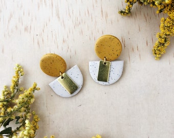 Clay and brass earrings - Speckled sand with a large yellow ochre stud.