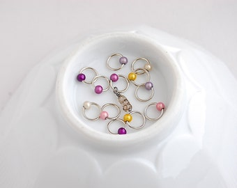 Mini Egg vs. 2, charmed:  12 Medium snag free ring knitting stitch markers.