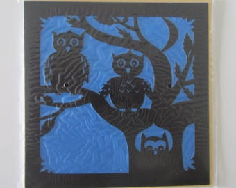 beautiful cut out card are three owls or owls shadow