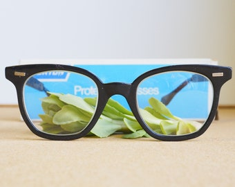 Vintage Eyeglasses 1970s/Glasses/New Old Stock/Safety Googles/ Black Toned By Norton With Adjustable temple length Frames
