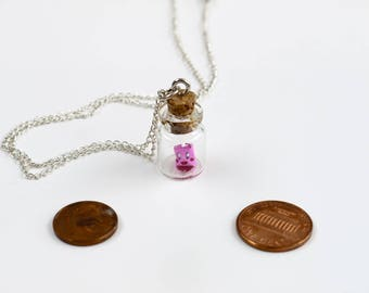 Pendant origami Kirby in tiny glass bottle