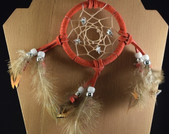 Small red wrapped dream catcher with metal flowers, white and silver beads