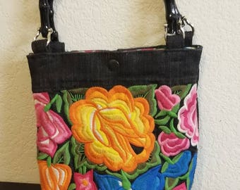 Embroidered denim purse made from re-purposed denim vest.