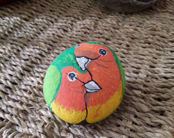 Love birds painted on stone