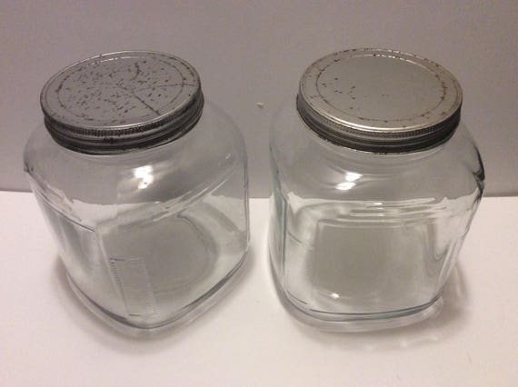 Two vintage glass storage jars containers with metal lids