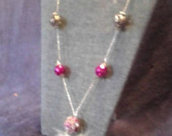 Pink feather Indian bead