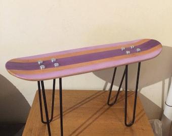 Purple skateboard deck table