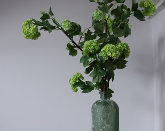 Arrangement of Faux Snowball stems in a recycled frosted glass effect vase.