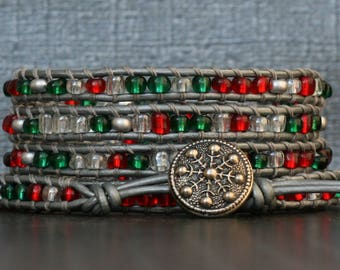 christmas bracelet - snowflake bracelet - holiday bracelet - red green silver clear seed beads on silver leather - beaded leather wrap