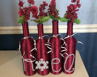 Metallic Maroon and Silver Accented Christmas Wine Bottle Centerpiece that spells Noel