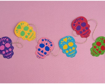 Multi-colored glitter dia de los muertos skull garland strung on metallic gold & natural colored hemp twine  READY TO SHIP