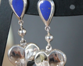 Sterling 925 earrings with Lapis Lazuli inlaid and dangling hearts. Lovely.