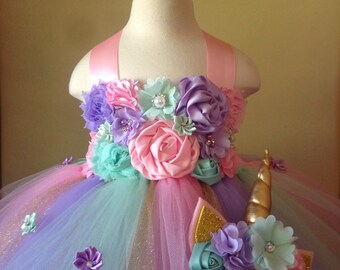 beautiful unicorn theme tutu dress in pastel colors  with a matching headband