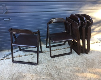 Vintage italian mid century modern brown plastic folding chairs