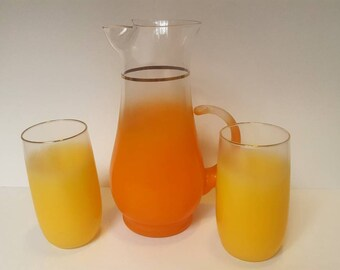 Blendo orange pitcher and Tumblers