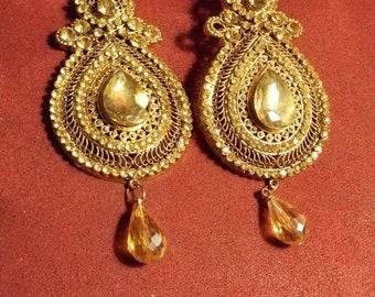 Dull gold earrings