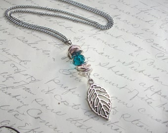 Leaf pendant silver necklace with blue crystal