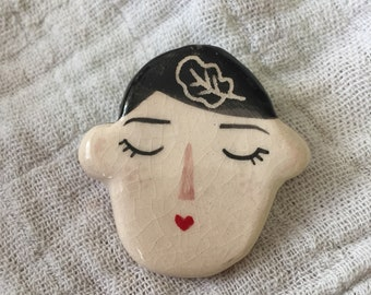 Ceramic face brooch