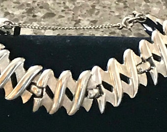 Vintage Monet Brush Smooth Silver Tone X Bracelet Safety Chain Signed