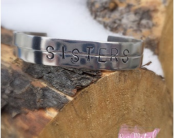 Sisters or CUSTOM word Aluminum handstamped cuff bracelet fit together to make word two pieces