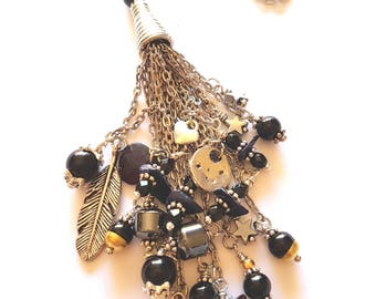 Long pendant flashes and stones