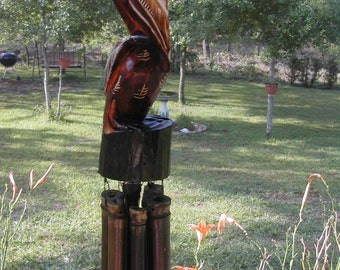 NEW 24 Inch Hand Carved Solid Wood Pelican & Bamboo Wind Chime. Stained mahogany , painted, sealed. Natural bamboo chimes .