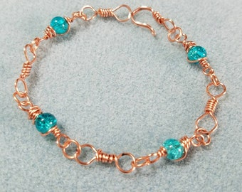 Brilliant Teal Glass Caged beaded Hand Twisted Copper Bacelet