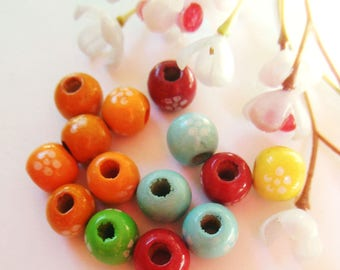 set of 15 round beads wooden patterns and colors vary