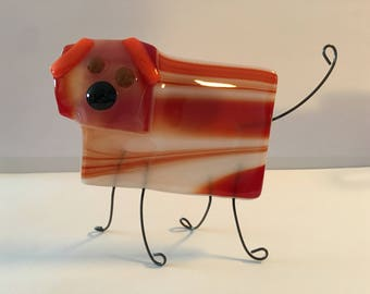 Homemade fused glass bacon-colored decorative dog. A bacon hound.
