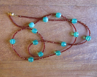 Exciting Mata Hari necklace in turquoise and ruby red