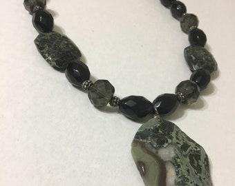 Black faceted pendant necklace