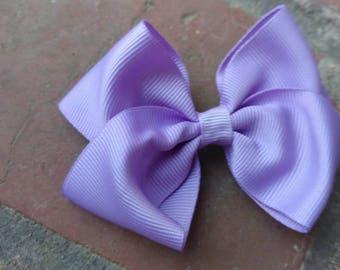 Medium size light purple lavender hair bow. Medium light purple hair bow. Light perpule hair bow. Medium lavender hair bow. Lavander bow