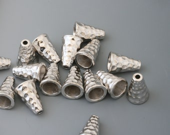 Jewelry cones. Tierracast cones. Hammered silver. 21 pieces.