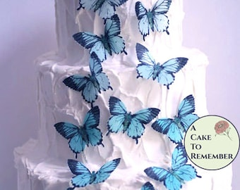 15 large edible butterflies in various colors for cake decorating. Wafer paper butterflies, wedding cake toppers, cupcake decorations