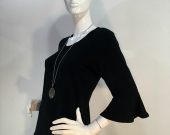 Plus size 1X-4X black bamboo top with flounced 3/4 sleeves and scoop neck.
