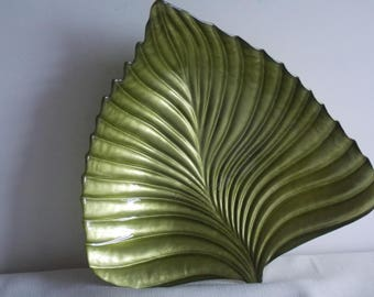 A green pressed glass leaf dish.