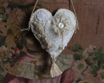 Ecru wool felt heart made with vintage laces,  pearl buttons and faux pearls