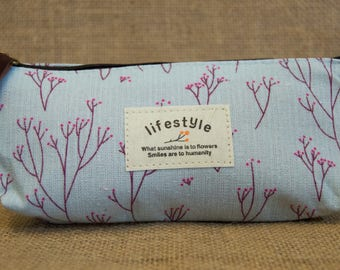 Cute blue makeup bag with flowers