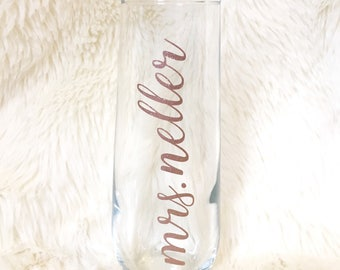 Custom Mrs. new last name champagne flute - stemless, bridal shower, bride, engagement party, in rose gold glitter, personalized